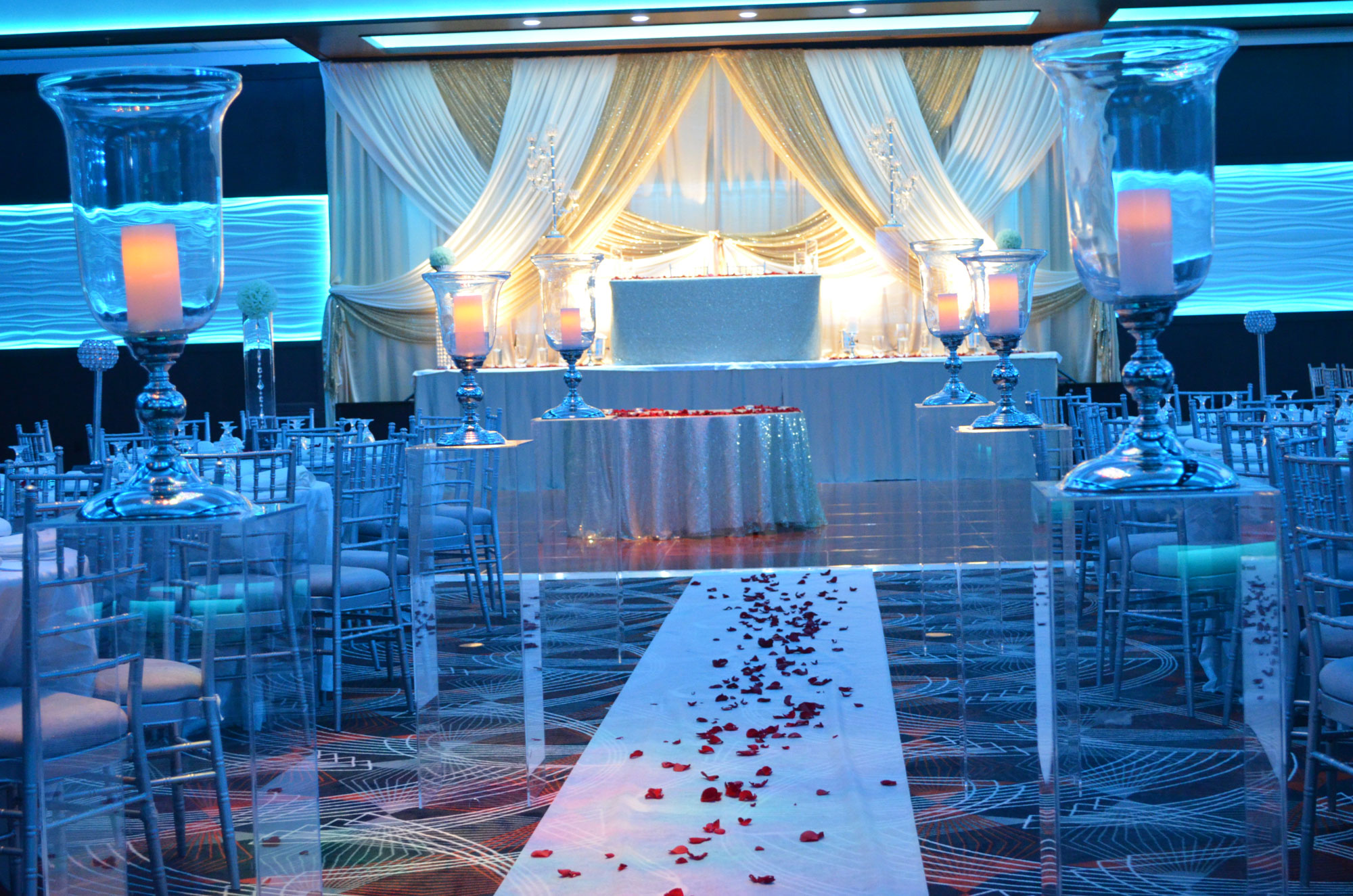 Aria Banquet Hall - wedding reception - decor - lighting - decorations - isle way - cake - table - stage - surrey - corporate event